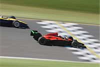 Two formula race cars crossing finish line (Digital Composite) Stock Photo - Premium Royalty-Freenull, Code: 6106-06979029