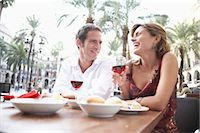 Spain, Barcelona, Placa Real, couple at outdoor cafe, laughing Stock Photo - Premium Royalty-Freenull, Code: 6106-06979151