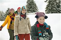 Parents and children (9-13) walking along in snow, smiling, close-up Stock Photo - Premium Royalty-Freenull, Code: 6106-06979784
