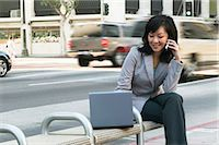 people sitting on bench - Woman sitting on bench using mobile phone with laptop Stock Photo - Premium Royalty-Freenull, Code: 6106-06979817