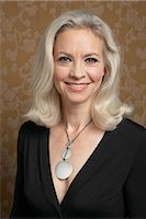 Mature woman smiling, portrait Stock Photo - Premium Royalty-Freenull, Code: 6106-06980041
