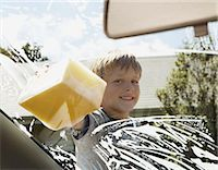 short hair - Boy (6-8) cleaning car windscreen with soapy sponge, smiling, portrait Stock Photo - Premium Royalty-Freenull, Code: 6106-06980263