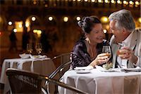 Italy, Venice, couple at restaurant table at night, outdoors Stock Photo - Premium Royalty-Freenull, Code: 6106-06980781