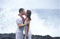 USA, Hawaii, Big Island, man and woman kissing on beach, side view Stock Photo - Premium Royalty-Freenull, Code: 6106-06981893
