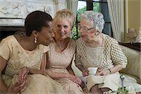 Two senior women and mature woman talking on sofa Stock Photo - Premium Royalty-Freenull, Code: 6106-06982618