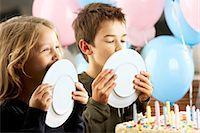 preteen girl licking - Children (5-10 years) licking plates at birthday party Stock Photo - Premium Royalty-Freenull, Code: 6106-06984253