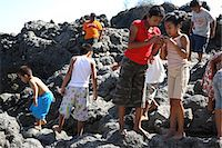 Children (4-10) exploring among rocks at beach Stock Photo - Premium Royalty-Freenull, Code: 6106-06984637