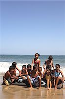 preteen girl wet clothes - Children (4-10) sitting on inflatable toy on beach Stock Photo - Premium Royalty-Freenull, Code: 6106-06984646