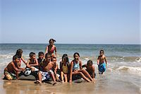 preteen girl wet clothes - Children (4-10) on beach playing in sea Stock Photo - Premium Royalty-Freenull, Code: 6106-06984647