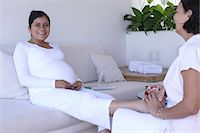 foot massage - Pregnant woman having foot massage and pedicure Stock Photo - Premium Royalty-Freenull, Code: 6106-06984652