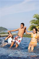 Teenagers (15-17) playing in swimming pool Stock Photo - Premium Royalty-Freenull, Code: 6106-06984697