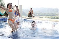 Teenagers (15-19) playing in swimming pool Stock Photo - Premium Royalty-Freenull, Code: 6106-06984700