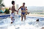 Teenagers (15-19) playing in swimming pool Stock Photo - Premium Royalty-Freenull, Code: 6106-06984704