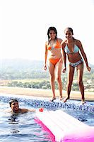 Teenagers (15-19) playing in swimming pool Stock Photo - Premium Royalty-Freenull, Code: 6106-06984706