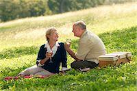 Senior couple having picnic Stock Photo - Premium Royalty-Freenull, Code: 6106-06985049
