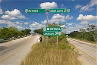 Highway signs of 180 toll road pointing to Merida and Cancun, Yucatan Peninsula Stock Photo - Premium Royalty-Freenull, Code: 6106-06985059