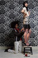 Fashion designer pinning female model's skirt, close-up Stock Photo - Premium Royalty-Freenull, Code: 6106-06985264