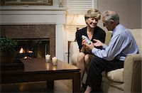 Man giving present to woman, smiling Stock Photo - Premium Royalty-Freenull, Code: 6106-06986347