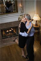 Senior couple embracing while dancing, smiling, elevated view Stock Photo - Premium Royalty-Freenull, Code: 6106-06986354