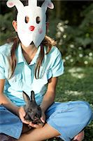 preteen touch - Girl (10-11) wearing rabbit mask, holding rabbit, portrait Stock Photo - Premium Royalty-Freenull, Code: 6106-06987297