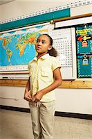 story - Girl (8-9) standing and talking in front of classroom Stock Photo - Premium Royalty-Freenull, Code: 6106-06987375