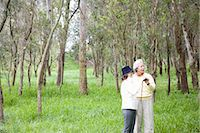 Mature couple bird watching in forest Stock Photo - Premium Royalty-Freenull, Code: 6106-06987535