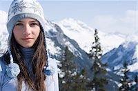 Teenage girl (14-15) in alpine landscape, wearing cap with pompoms, portrait Stock Photo - Premium Royalty-Freenull, Code: 6106-06987833