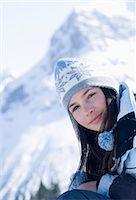 Teenage girl (14-15) in alpine landscape, close-up, portrait Stock Photo - Premium Royalty-Freenull, Code: 6106-06987835
