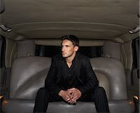 Young man sitting in limousine, looking aside Stock Photo - Premium Royalty-Freenull, Code: 6106-06988062
