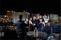 USA, Nevada, Las Vegas, Man photographing group of people standing on terrace Stock Photo - Premium Royalty-Freenull, Code: 6106-06988136