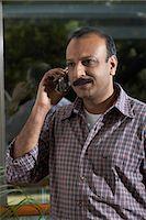 Businessman using cellphone Stock Photo - Premium Royalty-Freenull, Code: 6106-06988409