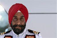 Doorman wearing turban, portrait Stock Photo - Premium Royalty-Freenull, Code: 6106-06988419