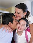 Parents embracing daughter (10-11), close-up Stock Photo - Premium Royalty-Freenull, Code: 6106-06988595