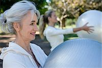 Mother and daughter holding exercise balls in park Stock Photo - Premium Royalty-Freenull, Code: 6106-06989837