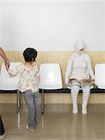 funny looking people - Girl (5-7 years) looking at bandaged patient in waiting room Stock Photo - Premium Royalty-Freenull, Code: 6106-06989867