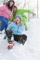 Three friends playing in snow Stock Photo - Premium Royalty-Freenull, Code: 6106-06990173