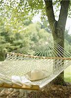 Hammock, Book, Hat, and Glasses Stock Photo - Premium Royalty-Freenull, Code: 6106-06990661