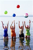 Four Women Stretching in a Lake Stock Photo - Premium Royalty-Freenull, Code: 6106-06990663