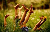 sole - Girls Playing in the Grass Stock Photo - Premium Royalty-Freenull, Code: 6106-06990804
