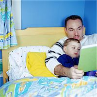 story - Father Reading to Son Stock Photo - Premium Royalty-Freenull, Code: 6106-06990932
