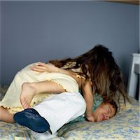 Brother and Sister Play Fighting Stock Photo - Premium Royalty-Freenull, Code: 6106-06990939