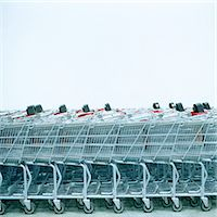 empty shopping cart - Row of shopping carts, side view Stock Photo - Premium Royalty-Freenull, Code: 6106-06990985