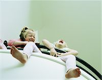 Two girls (6-8) laughing, low angle view Stock Photo - Premium Royalty-Freenull, Code: 6106-06991409