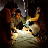 Doctor and Nurses Assisting a Patient Stock Photo - Premium Royalty-Freenull, Code: 6106-06991757