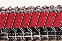 Row of red shopping carts, side view Stock Photo - Premium Royalty-Freenull, Code: 6106-06992695