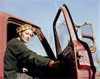 female truck driver - Young woman sitting in truck with the door open, portrait Stock Photo - Premium Royalty-Freenull, Code: 6106-06992937
