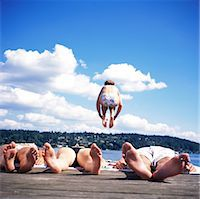 female 16 year old feet - Teenagers (14-16) lying on dock, girl jumping into lake, rear view Stock Photo - Premium Royalty-Freenull, Code: 6106-06993592