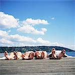 Four teenagers (14-16) sunbathing on dock Stock Photo - Premium Royalty-Free, Code: 6106-06993593