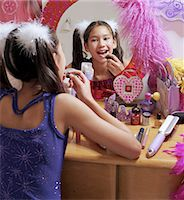 preteen girl pigtails - Girl (10-12) applying lipstick, looking in mirror, rear view Stock Photo - Premium Royalty-Freenull, Code: 6106-06994327