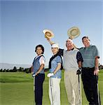 Two mature couples on golf course, holding golf clubs, portrait Stock Photo - Premium Royalty-Freenull, Code: 6106-06994404